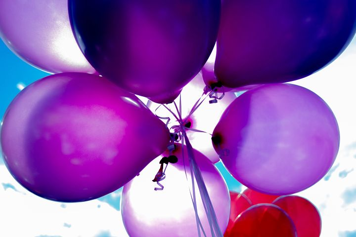 violet and red balloons