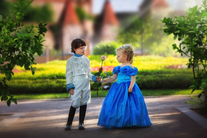 little girl wearing a blue dress, with his prince wearing a suit