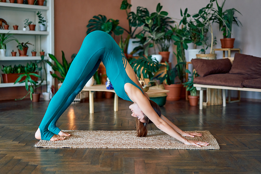 Woman trying out yoga online learning course