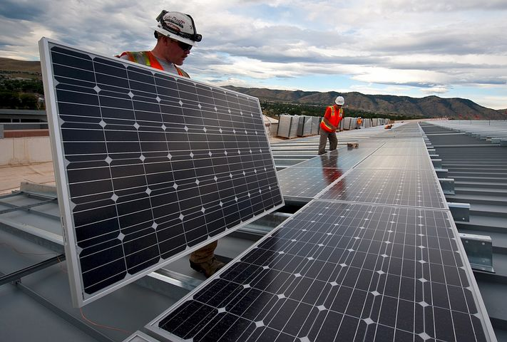 Two workers providing commercial solar financing plans